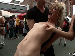 Blond grumble is caned outdoors at equal