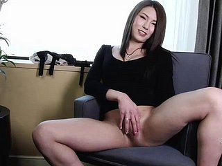 Japanese tranny dick gets hard as a rock as she strokes